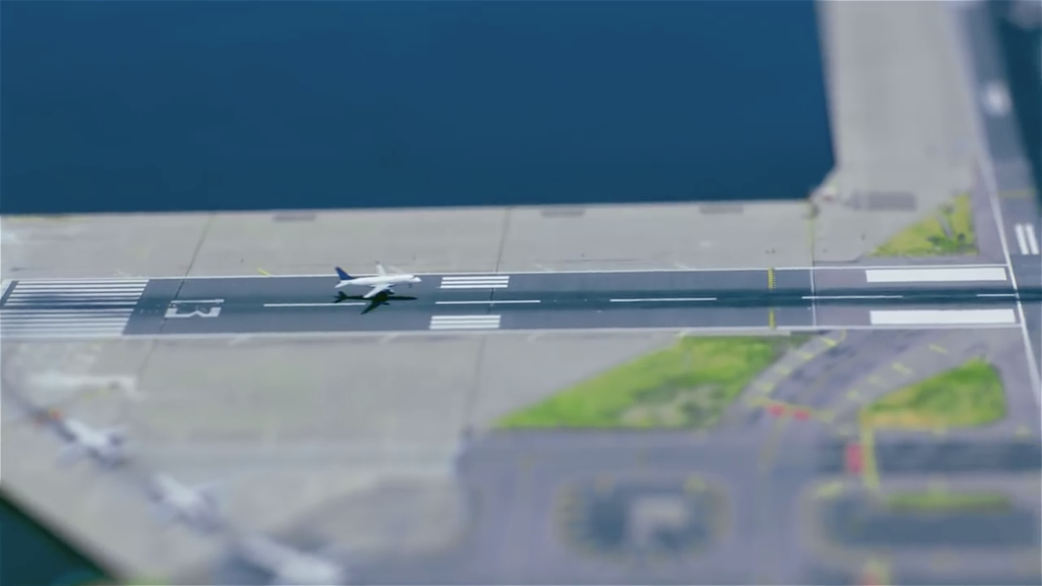 The video then travels to the borough of Queens, where LaGuardia Airport is located. The East River and Rikers Island Channel surround runway 13/31, the longest runway at the airport by just one metre.