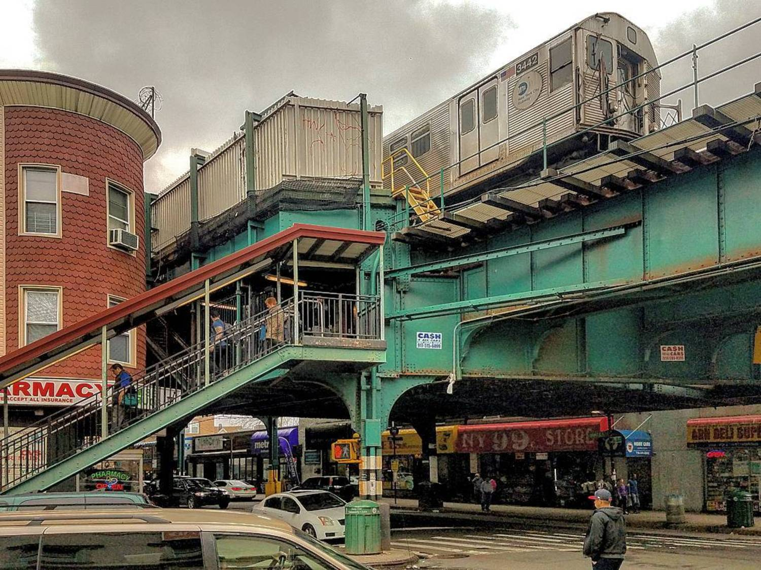 A #J_train leaves the #111th_Street_Station.