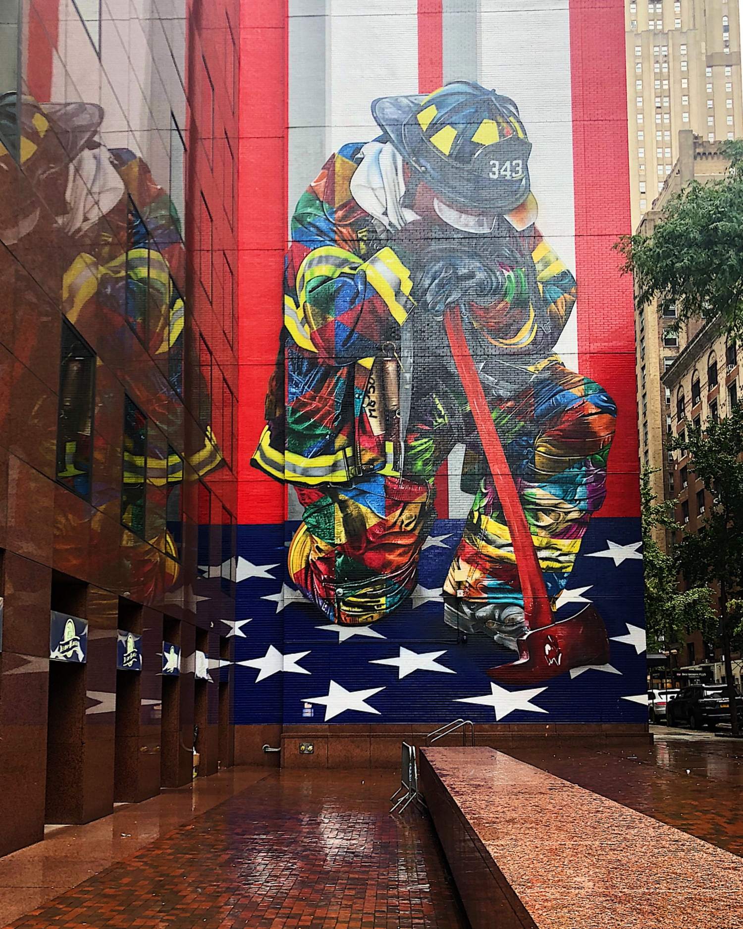 Reflection  The finished #mural of @kobrastreetart 's rendition of the iconic 9/11 photograph w/ New York's Bravest! @fdny👩🏻‍🚒👨🏻‍🚒 Swipe 👉🏻for another 📸 ❤️🧡💛 🇺🇸 💚💙💜 ... #stars #stripes  #iconic #911 #fdny #color #wallporn #art #artist #muralart #eduardokobra #urbanart #reflection #streetart #ny #newyork #nyc #newyorkcity #bigapple #manhattan #ILoveNY #ilovenyc  #seeyourcity  #graffitiart #justgoshoot #ignyc #muralsofnyc #manhattanstreetart #justgoshoot