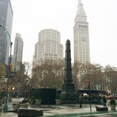 The monument sits along Madison Square Park, between Broadway and 5th Ave