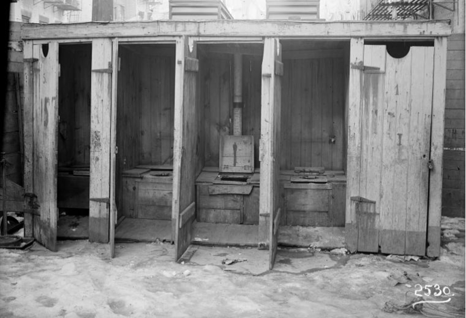 """Irma and Paul Milstein Division of United States History, Local History and Genealogy, The New York Public Library. """"Row of outhouses"""" The New York Public Library Digital Collections. 1902 – 1914."""
