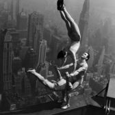 Acrobats performing at the opening of the Empire State Building, May 1st, 1931
