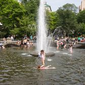 Girls swimming on a hot day in Washington Square Park.