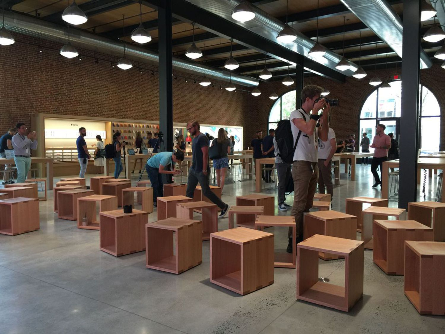 Apple says the wooden cubes are for customers and community members to gather.