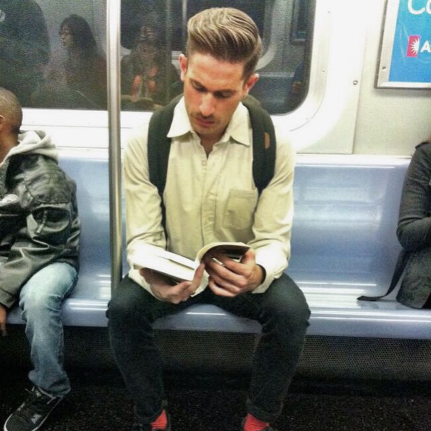 Whoa. This smoldering smokeshow stepped right off the pages of GQ and into my heart. That manly moustache almost makes me forget he has better hair than I do. When he puts down that book I hope he'll give me some tips #butjustthetips #hotdudesreading