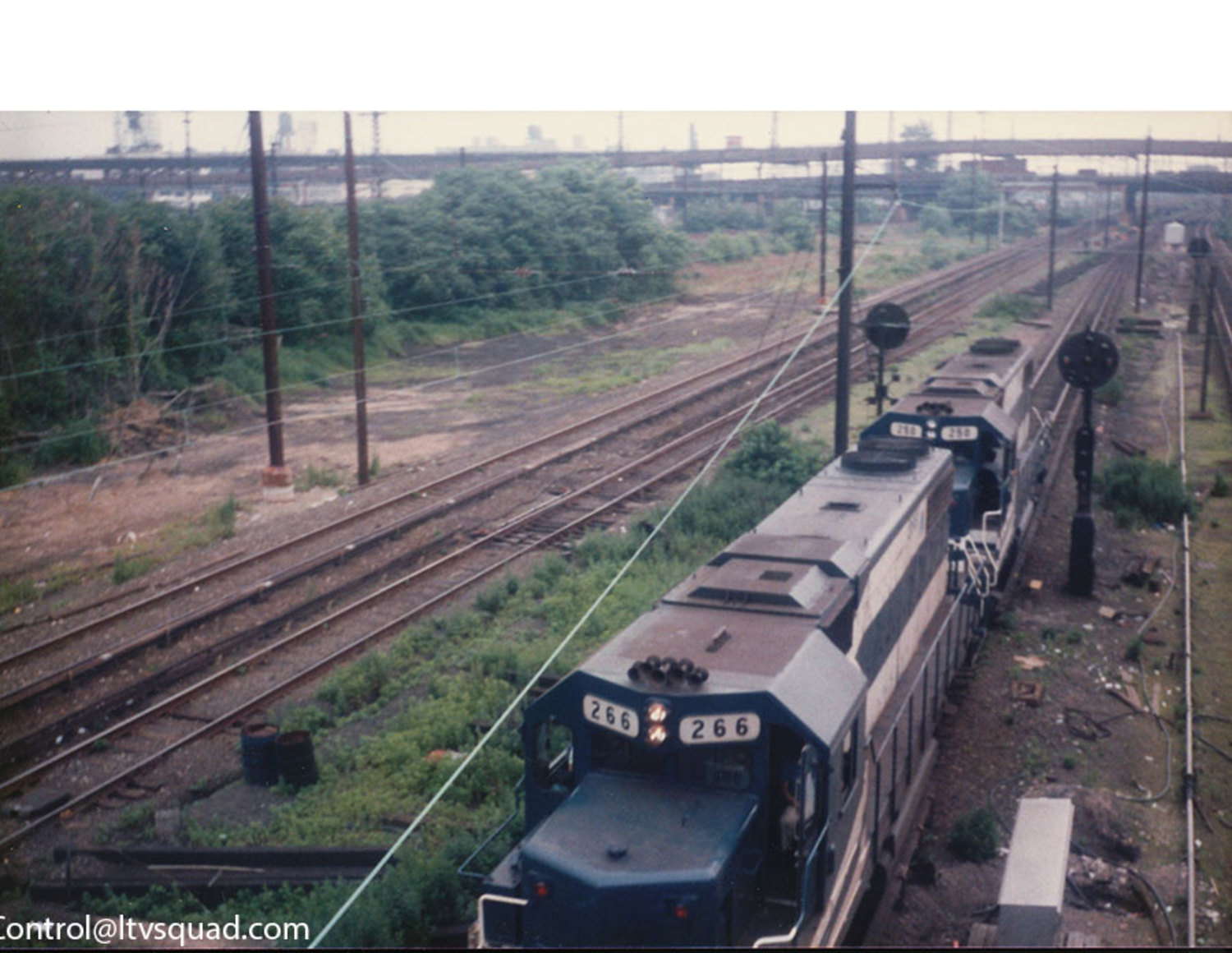 A set of LIRR 'GP-38-2' locomotives entering the 'Mainline' Cutoff at Thomson Avenue in 1989 (Queens blvd is in the background – the mainline cutoff is merely the ramp from the montauk cutoff into Harold interlocking)
