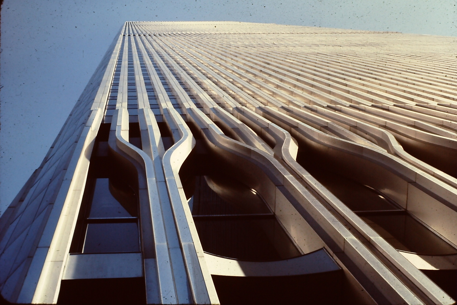 World Trade Centre 1986 | The original World Trade Center was designed by Minoru Yamasaki in the early 1960s using a tube-frame structural design for the twin 110-story towers. In gaining approval for the project, the Port Authority of New York and New Jersey agreed to take over the Hudson & Manhattan Railroad which became the Port Authority Trans-Hudson (PATH). Groundbreaking for the World Trade Center took place on August 5, 1966. The North Tower  was completed in December 1970 and the South Tower was finished in July 1971. Construction of the World Trade Center involved excavating a large amount of material which was used in making Battery Park City on the west side of Lower Manhattan.