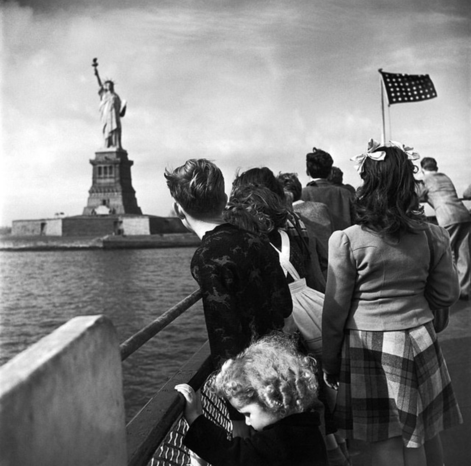 WWII refugee children viewing the Statue of Liberty as they enter the United States, 1946