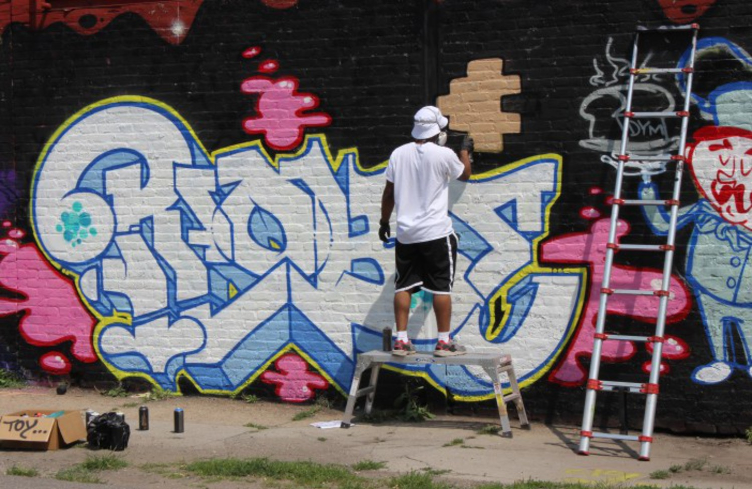 Graffiti artist working on a commissioned piece.