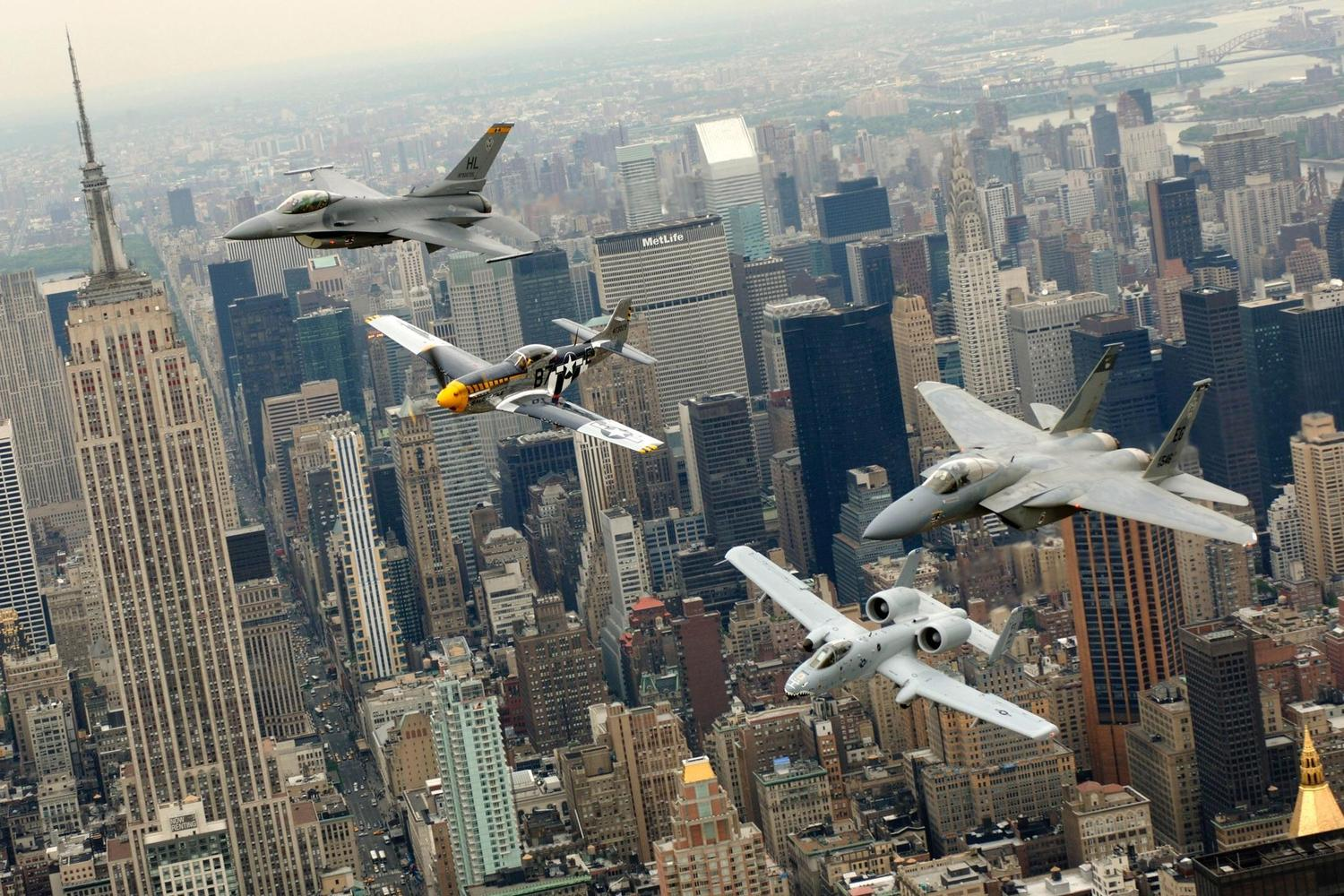 F-16, P-51, A-10 and an F-15 flying above New York City
