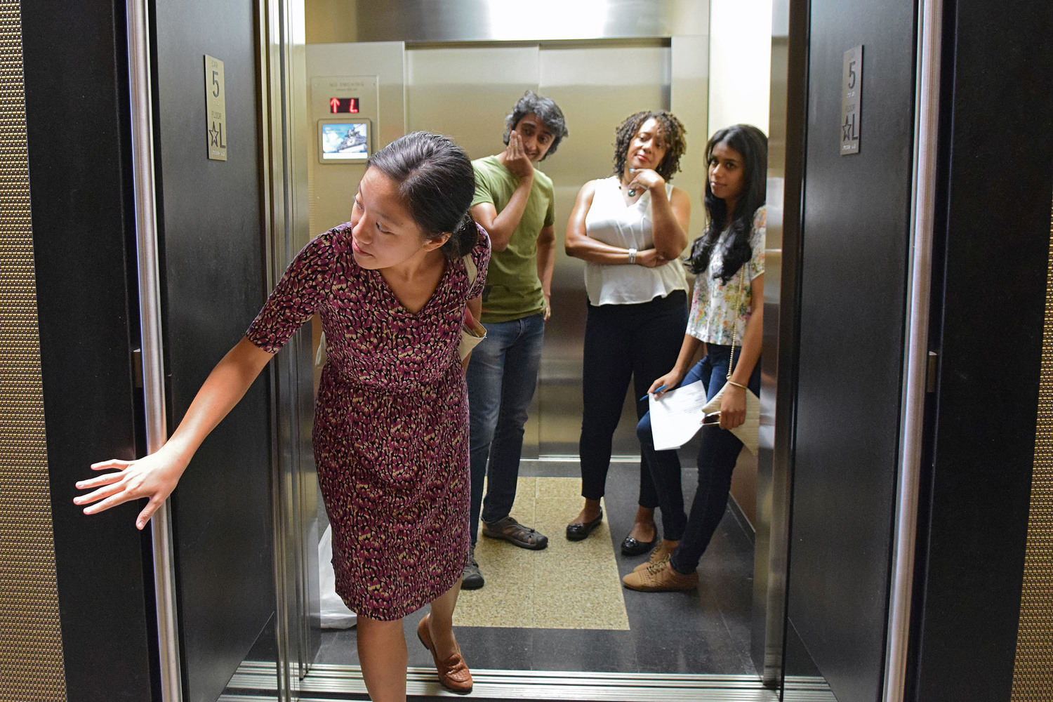 "Woman Holding Elevator Door While Other Passengers Wait Impatiently | You can use this photo for non-commercial purposes if you give credit, under this <a href=""https://creativecommons.org/licenses/by-nc/3.0/us/"" rel=""nofollow"">Creative Commons license</a>. For-profit media organizations also may use this, but as editorial content only (as illustrations for stories, for example, but not as advertising). Credit must read: Richard Yeh / WNYC  We'd love to know if you're using this photo - send us an email (jkeefe@wnyc.org)!"