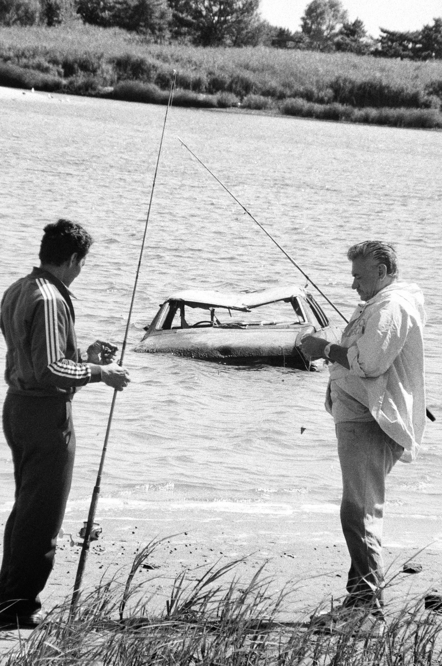 Fishermen at Gerritsen Inlet might find cars abandoned in the waters. Aug. 1, 1990.
