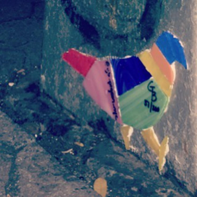 Pigeon 51 - E. 7th St between Ave A & B. #pigeon #eastvillage #tomkinssquarepark #nyc #streetlight #streetart #original #glass #art #nycstreetart #birdup #thegluedriesclear #wheatpaste #graffiti #thestreetsofnyc #colorful #streetlightpigeon #gbpigeonnyc #gbwashere