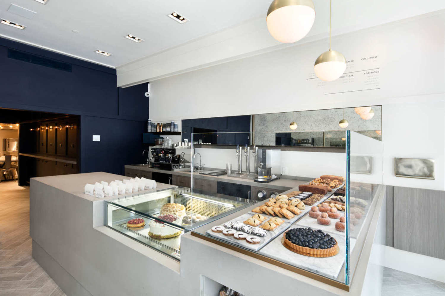 The design is clean and modern, with the pastries at center stage.