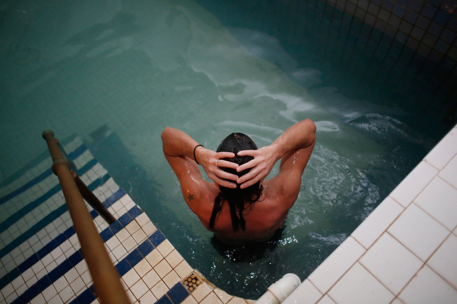 Jason Russell, 42, in the cold pool after sitting in the saunas.