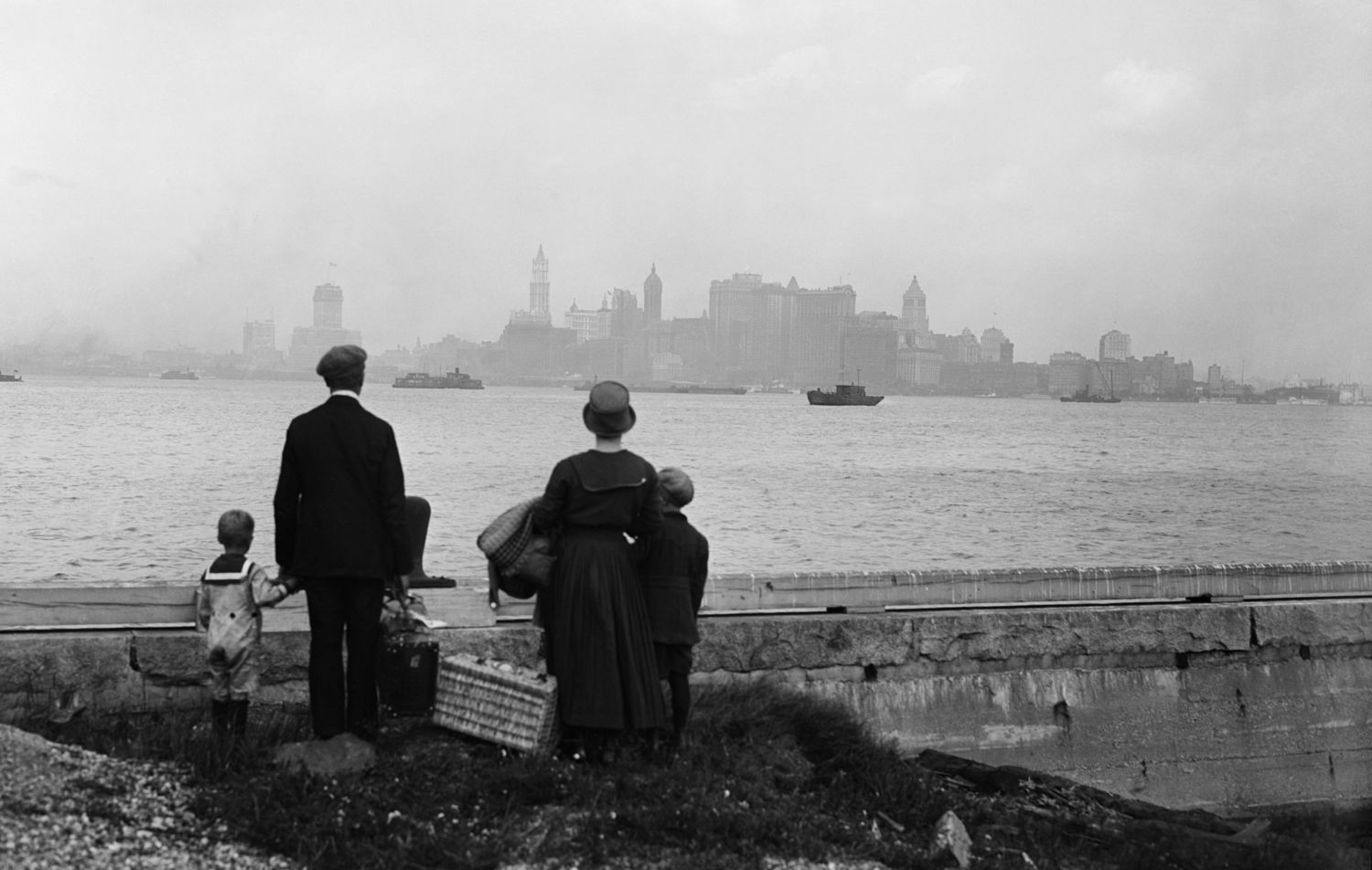 Immigrant Family Viewing New York City from Ellis Island (1925)