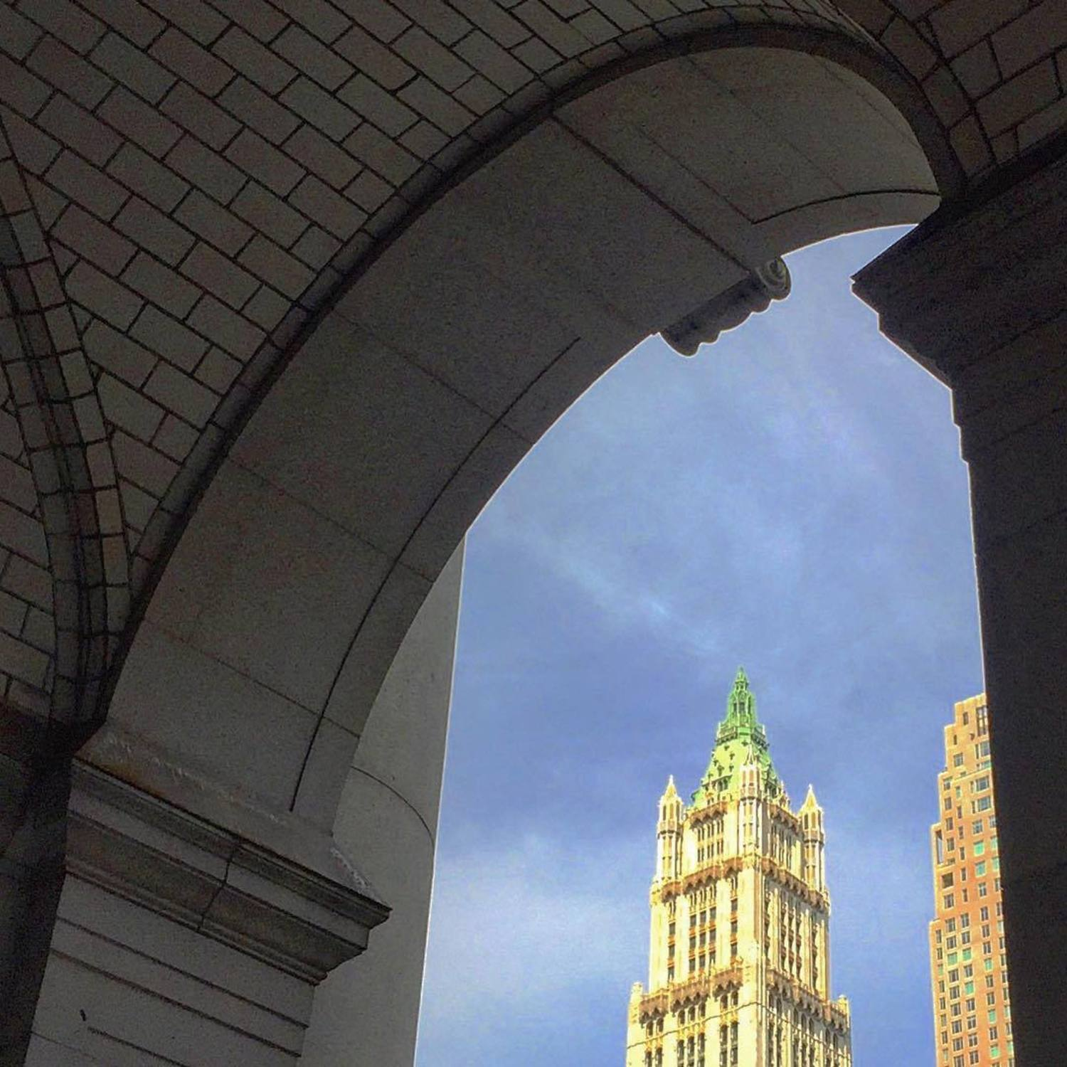 Peeking through the Municipal Building's Arch at the Woolworth Building.