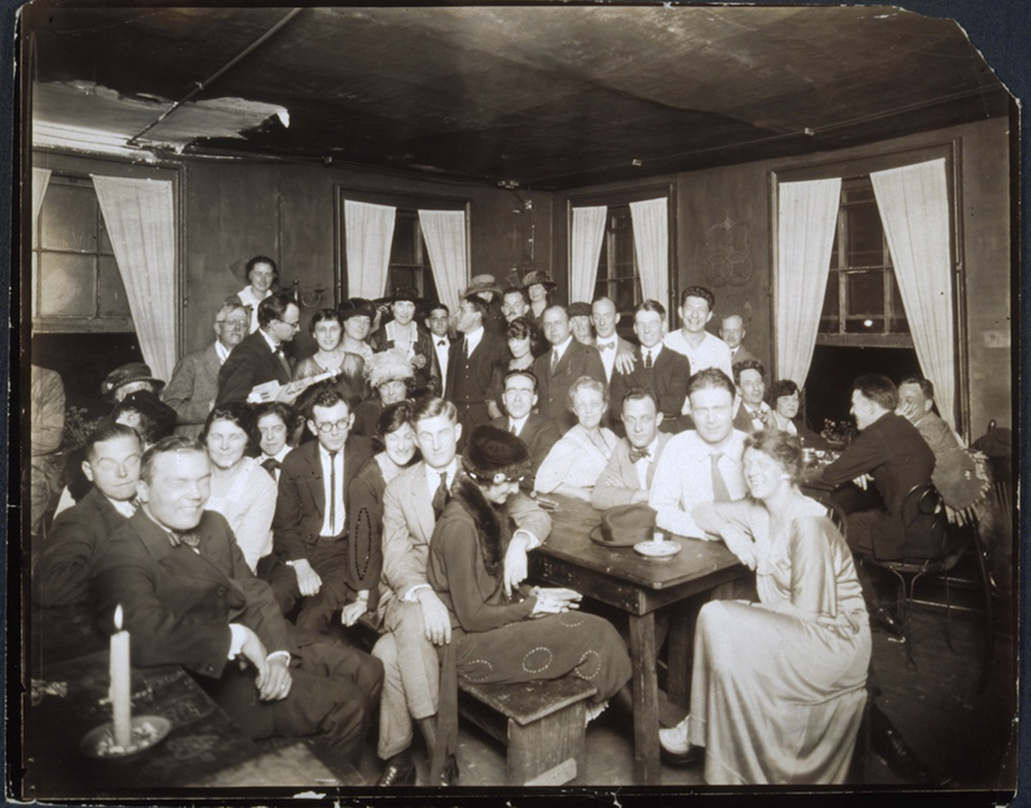 Group portrait, indoors, of people gathered at the Garrett Coffee House, circa 1912-1917; photograph by Jessie Tarbox Beals.