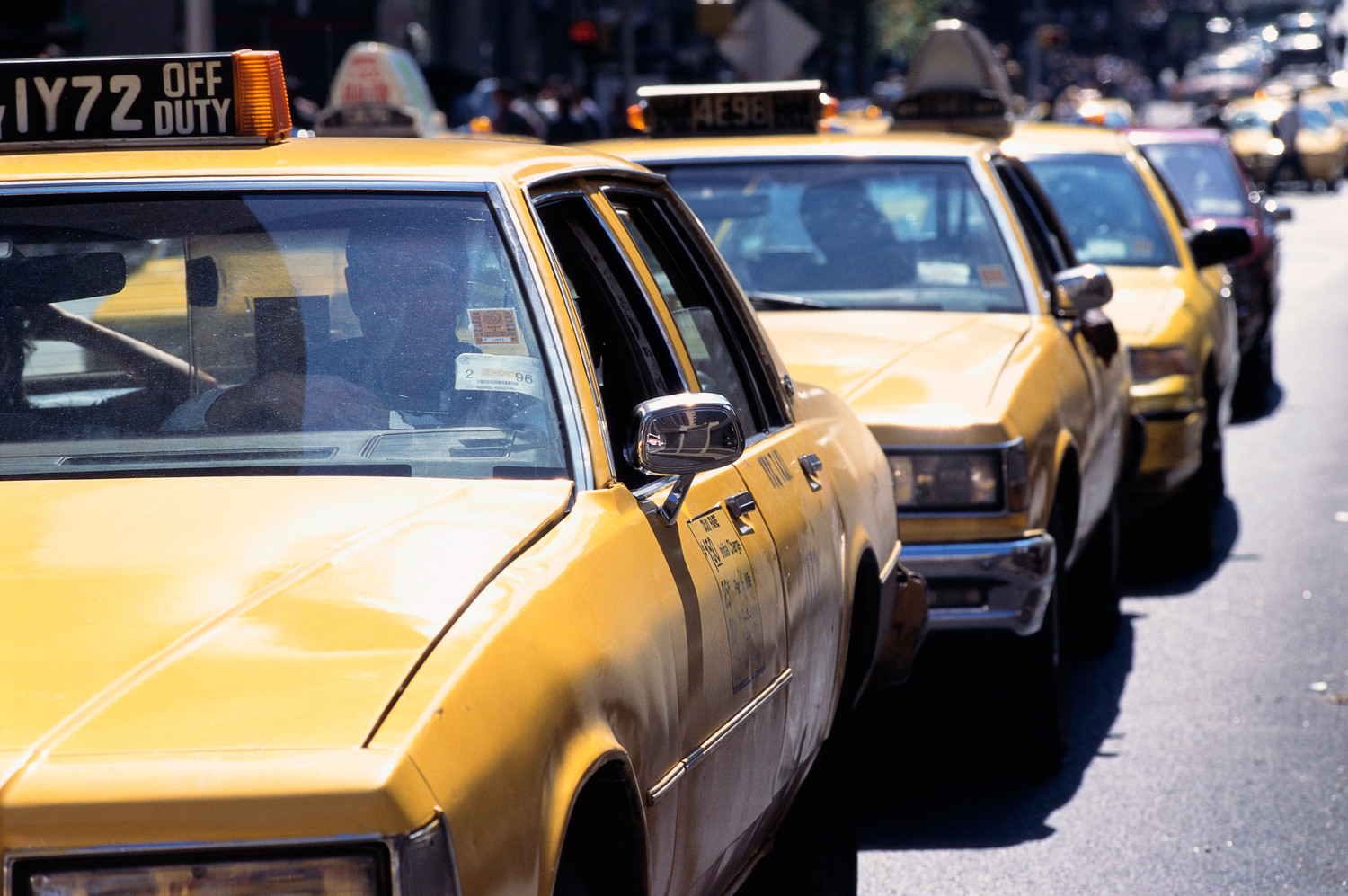 Taxis move through a traffic lane in New York City, 1995