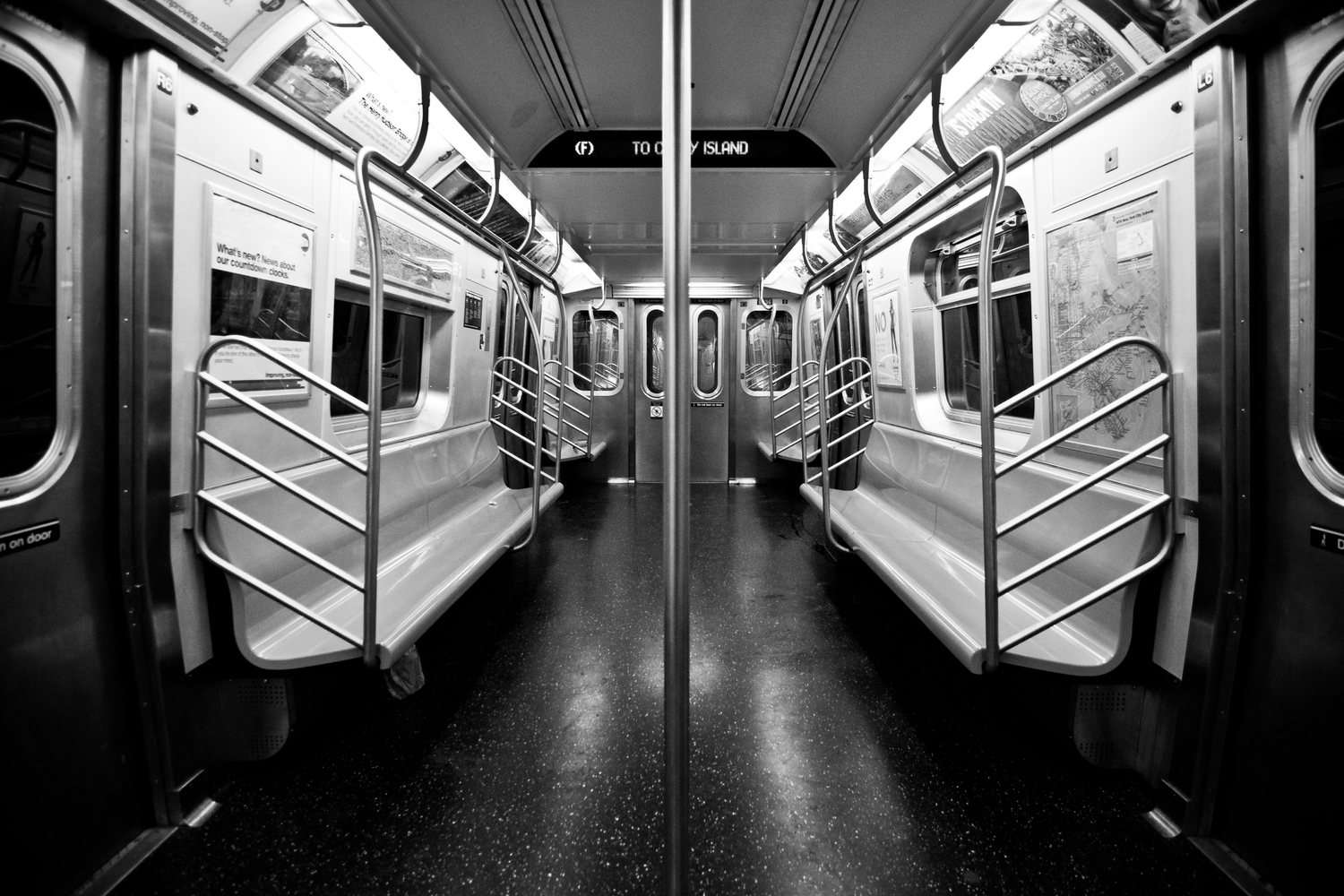 Modern Detachment   It was early in the morning, around 2AM. I just slept pass my stop by one freaking stop. I had to wait about 10 minutes in the freaking oven that is a MTA subway platform and was greeted by emptiness. I've always wanted to take a picture of an empty F train, and I finally got my chance.