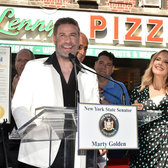 John Travolta is honored at Lenny's Pizza in Brooklyn on John Travolta Day.