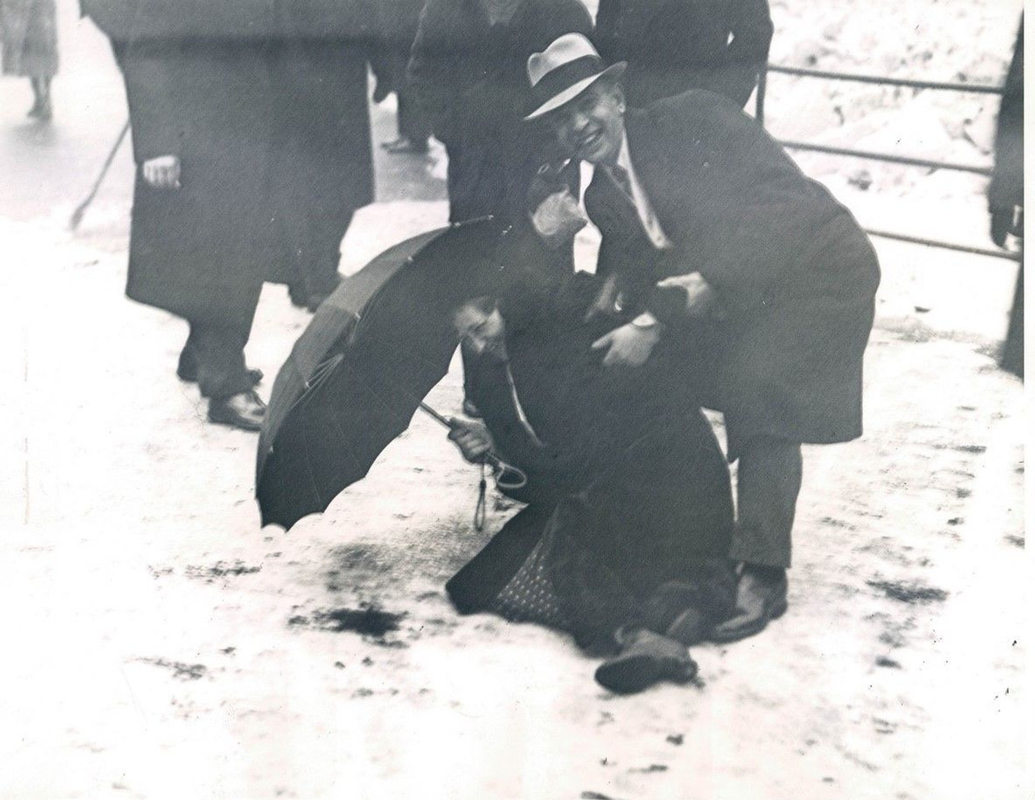 February 4 1936 Pedestrians help one another on slippery snowy sidewalks in New York photo Acme