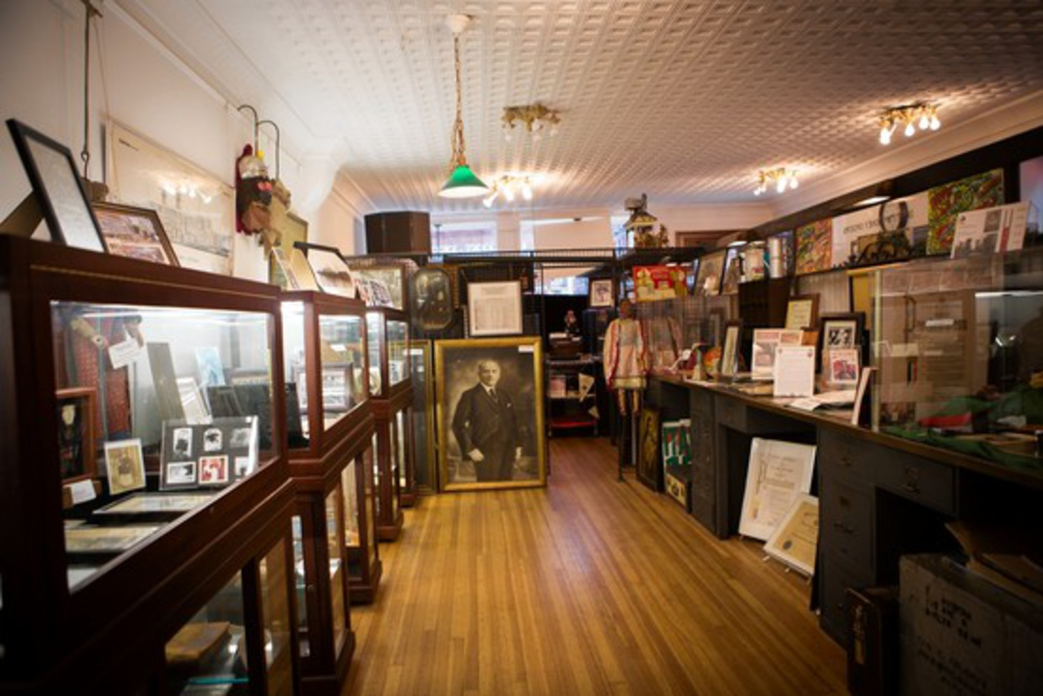 The Italian American Museum's main room offers displays of antique items representing Italian American culture.