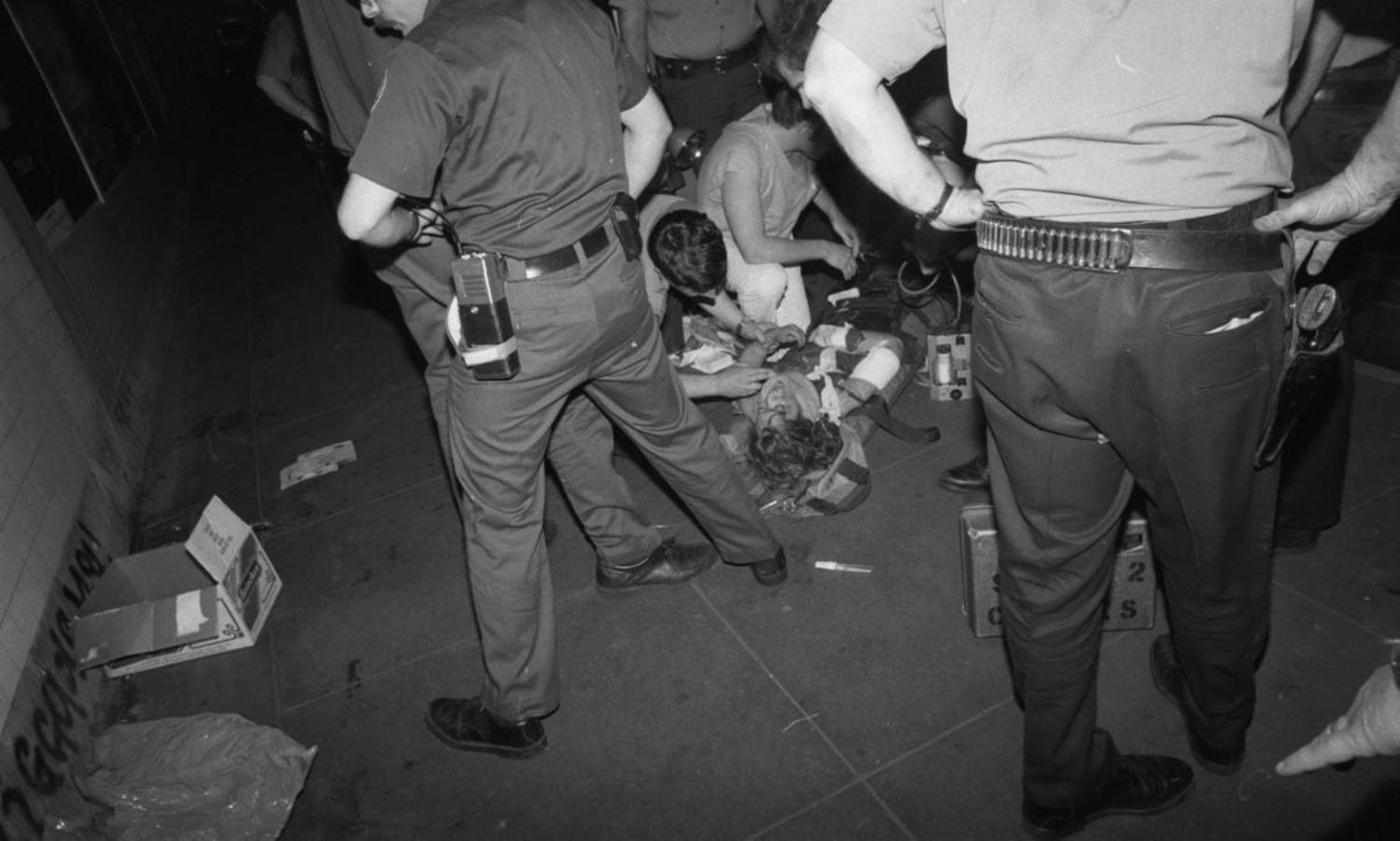 1970's: After a senseless subway attack, 17-year-old music student Renee Katz receives medical attention after her right hand was severed when she was pushed in front of a moving train at the 50th St. station.