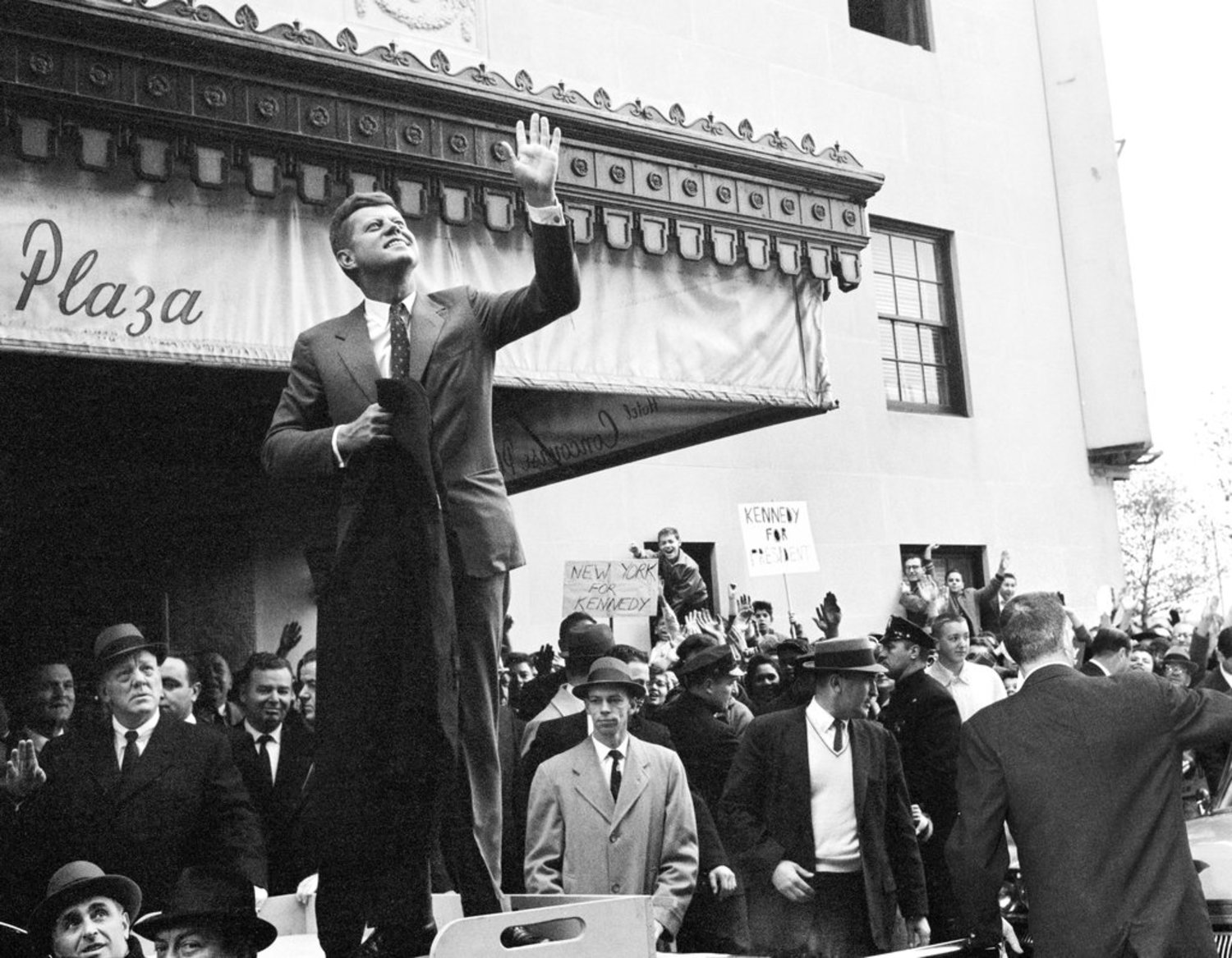 "Nov. 5, 1960: Senator John F. Kennedy was making closing arguments before overflow crowds in the New York area on the weekend before Election Day, despite heavy rains. ""I don't know any place in the United States where Democrats would turn out on a rainy Saturday afternoon like this,"" he said in Wantaugh, N.Y. ""I understand the sun is shining on Mr. Nixon in California. Well, it won't be shining after Tuesday,"" he said. Outside the Concourse Plaza Hotel in the Bronx, where Senator Kennedy stood on a car to be better seen by the throng, he was ""met by placards proclaiming 'The Home of the Bagel Knows Big Jack is Able.' """