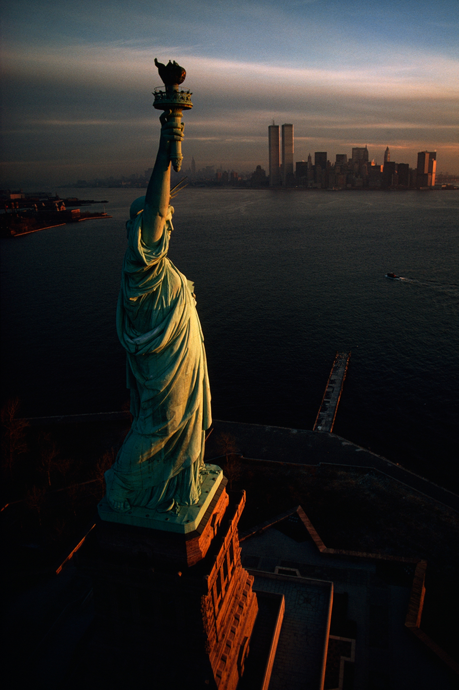 The Statue of Liberty hails dawn over New York Harbor in 1978.