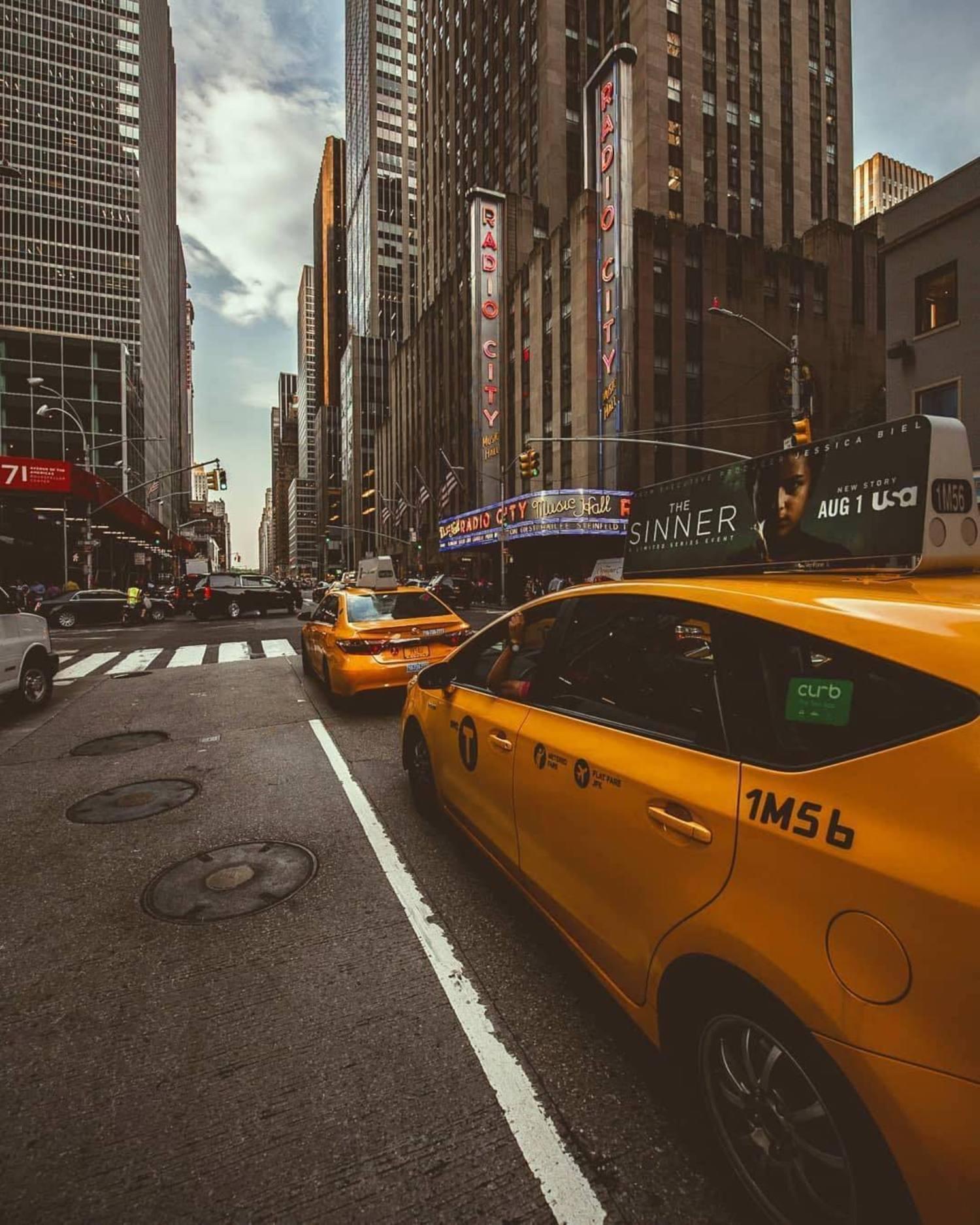 New York, New York. Photo via @m_bautista330 #viewingnyc #newyork #newyorkcity #nyc #taxis #6thavenue #radiocitymusichall