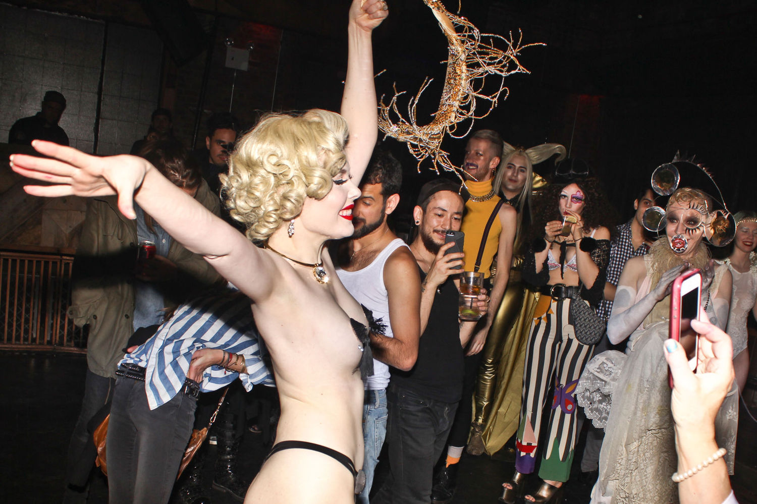 ...and delights the crowd with an impromptu strip tease.