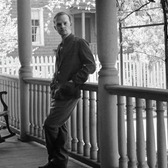 Truman Capote photographed on the porch of his Brooklyn Heights home, 1958