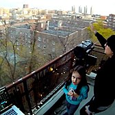 Neighbor hosts weekly dance parties on balcony in Washington Heights