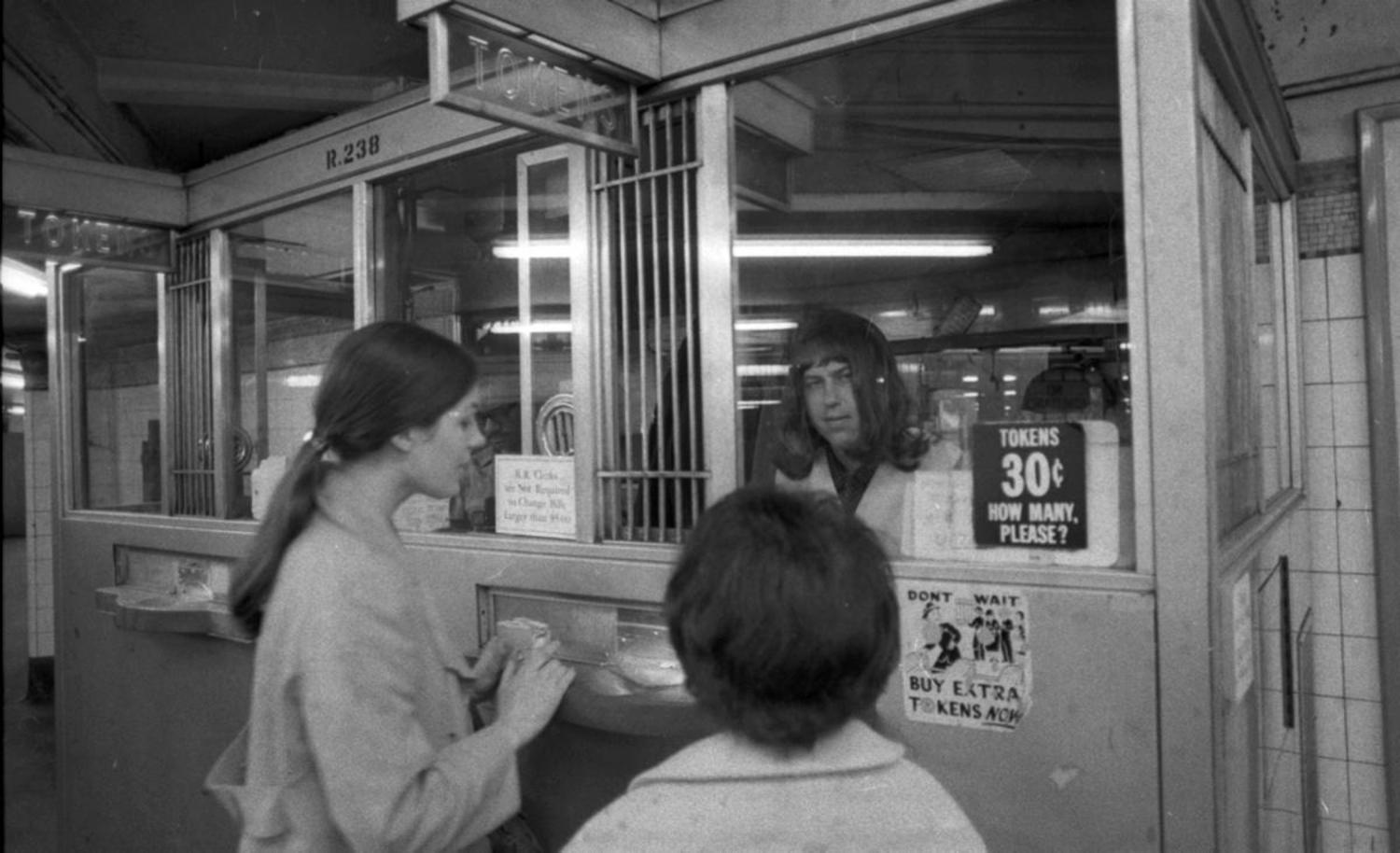 1970's: Undercover police officer Raymond Barse disguises himself as a female subway token clerk at the Grand Central station in order to halt the recent upsurge in subway armed robberies.