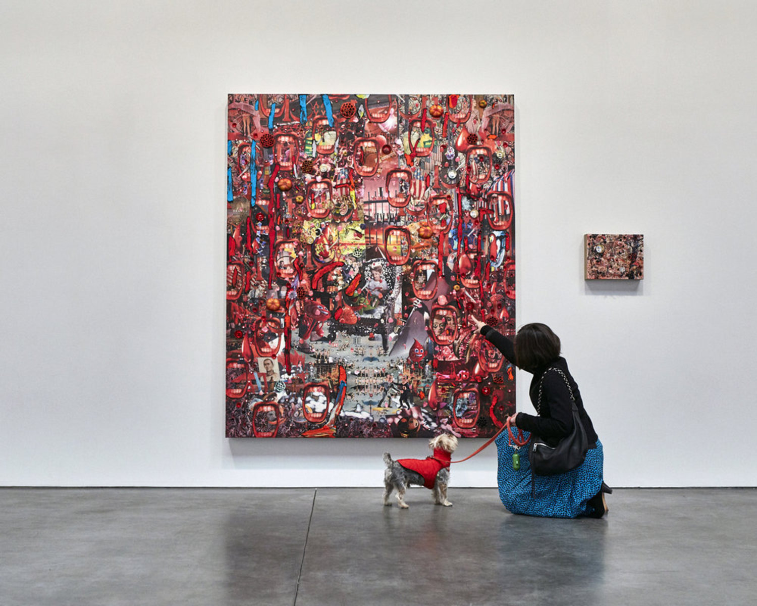 The color red is not visible to a dog's eyes, however this didn't stop Rocky from an interest in the surface and textures of this Elliott Hundley painting on view at Andrea Rosen Gallery.