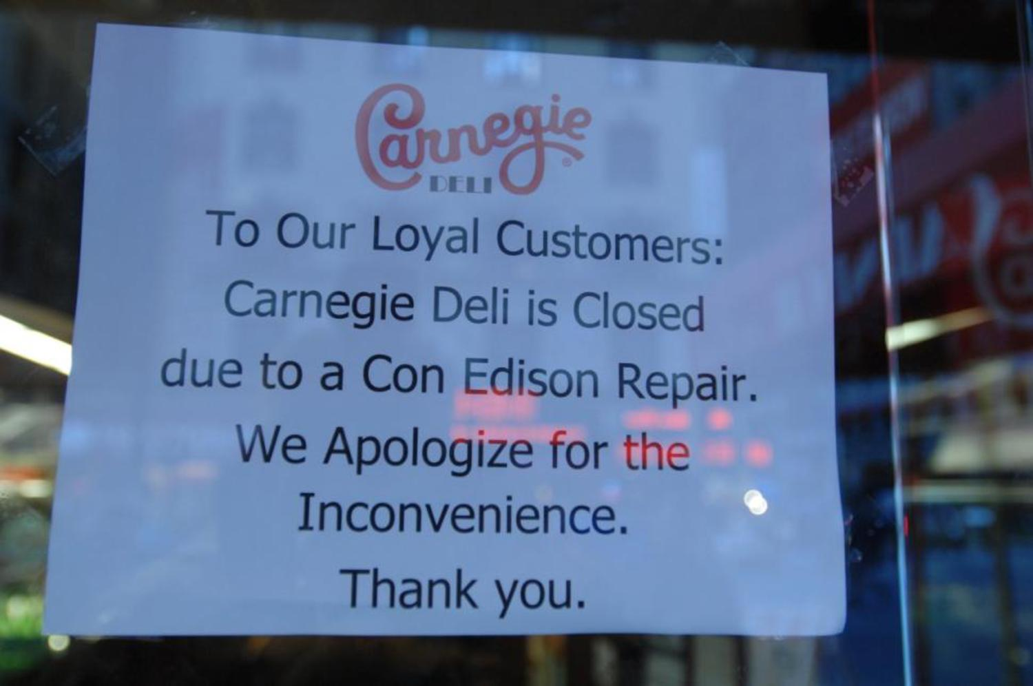 "A sign on the window of Carnegie Deli on Seventh Ave. Friday announces that it's closed for a ""Con Edison Repair."""