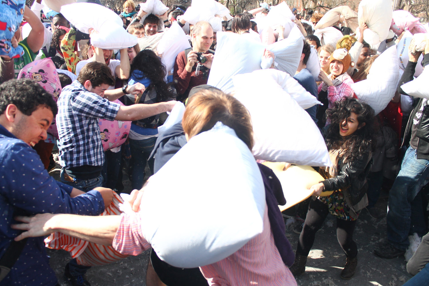 Pillow Warfare | Taken at the 2014 International Pillow Fight Day in Washington Square, New York City.