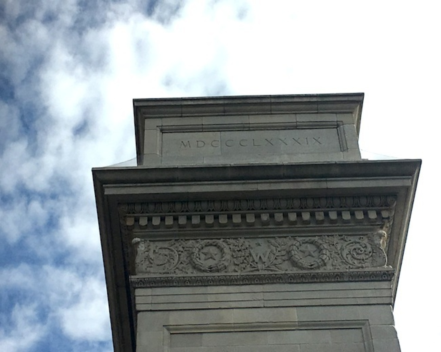 What is the Significance of the Roman Numerals on the Washington Square Arch? (western side of monument)