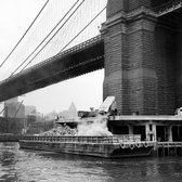 "Feb. 18, 1949: Garbage was dumped onto a scow at the base of the Brooklyn Bridge, on its way to Staten Island, where the city had high hopes to reclaim nearly 2,000 acres of marsh for a parkway or even an airport. ""We go everywhere against opposition and deep-rooted prejudice,"" said Henry F. Cunningham, a World War II naval commander who oversaw the fleet charged with taking trash to Fresh Kills landfills. ""We take a swampy area full of mosquitos and odors no better than those from refuse and transform it into fertile soil that can be made into beautiful parks,"" Mr. Cunningham said."
