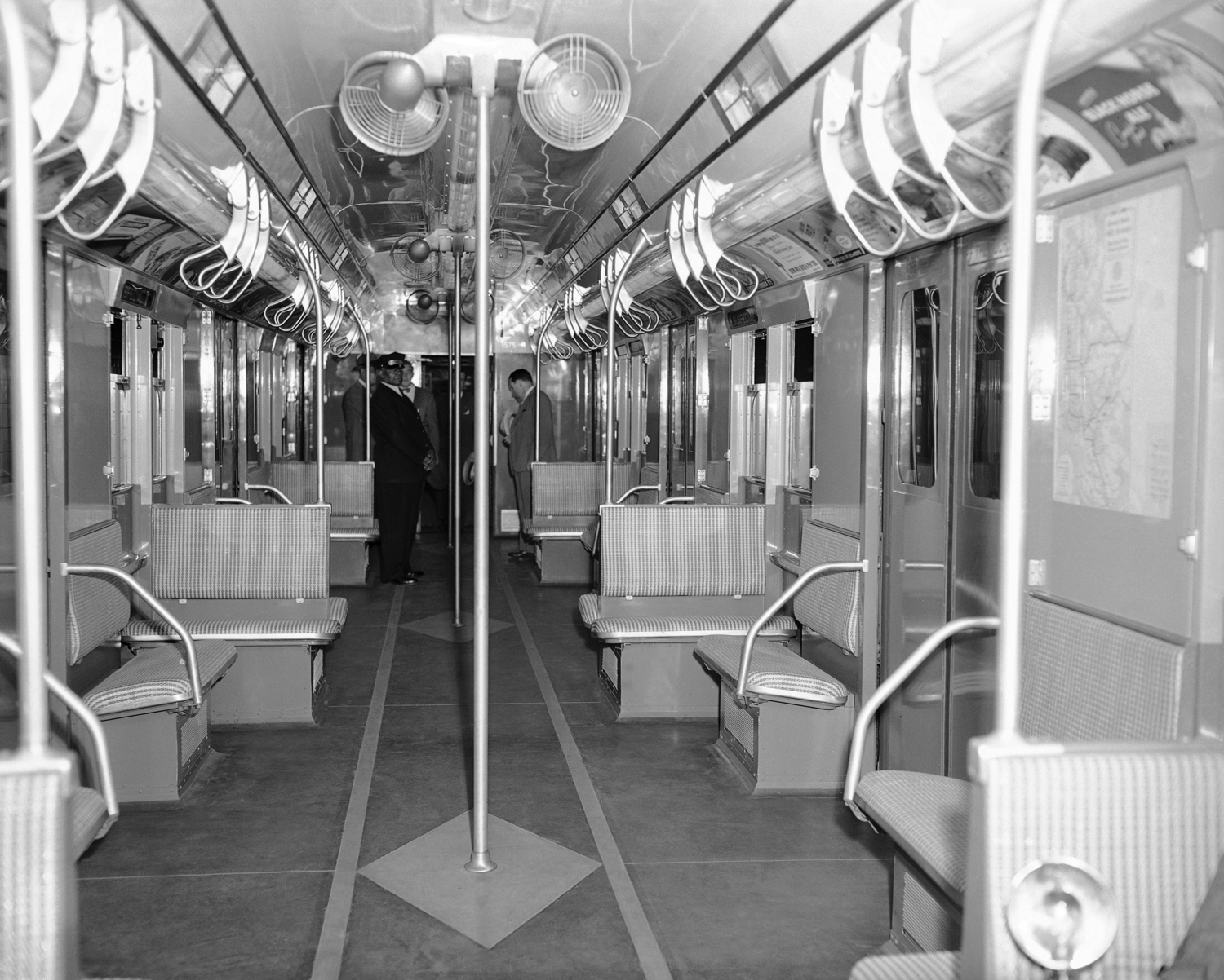 Interior view of the subway car of the future as it was displayed at the Chambers Street Station of the Independent Division in New York on July 9, 1947. The new car has 56 seats, 14 adjustable, exhaust ventilators, eight 10-inch fans, is painted blue and grey and has an off-white ceiling.