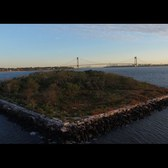 Phantom 3 Professional flies over mystery  island just off staten island's south beach