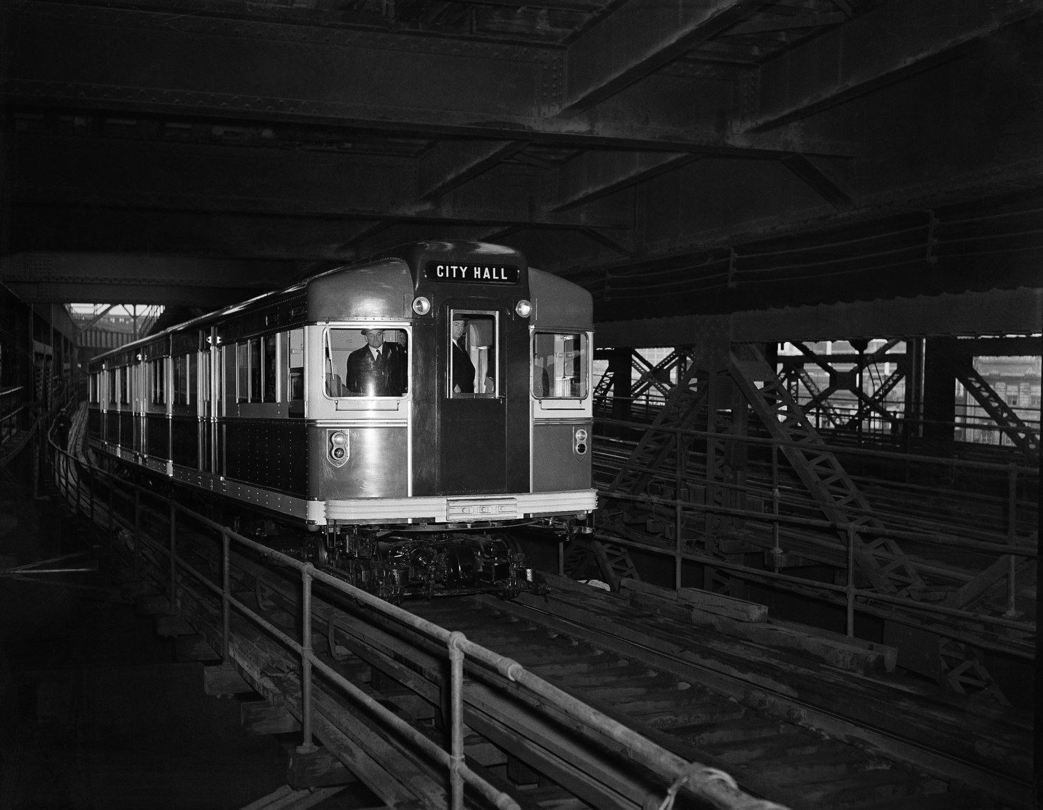 "The new streamlined red, white and blue Rapid Transit car which made its ""maiden voyage"" along the BMT lines in New York, March 28, 1939. It weighs 76,000 pounds, about half the weight of the conventional cars, and is equipped with special sound-deadening and shock-cushioning devices."