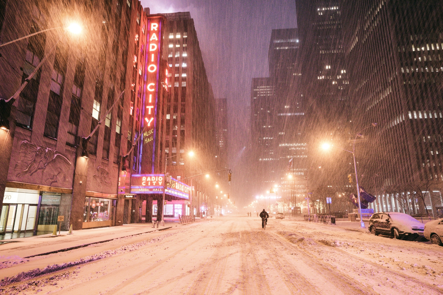 "New York City - Snow - Winter Storm Juno - Radio City Music Hall | Juno: The first snowstorm of 2015 in New York City.  ---  (Note: My <a href=""http://www.amazon.com/gp/product/1440339589/ref=as_li_tl?ie=UTF8&camp=1789&creative=9325&creativeASIN=1440339589&linkCode=as2&tag=nyththle0e-20&linkId=ER6GYT5FRYNMEPLF"" rel=""nofollow"">New York photography book</a> released worldwide in stores/online recently and has photos similar to this  [full info below])  ---  I have been photographing New York City during snowstorms at night for the past 5 years. When it comes to experiencing <a href=""http://nythroughthelens.com/tagged/snow"" rel=""nofollow"">New York City in the snow</a>, I relish the challenge. The more gusty, snowy, and brutal the storm, the more of a chance that I will be out in it traipsing around New York City with my cameras in tow.  When I heard that the MTA was suspending all transit service (and most vehicles) at 11 pm, I made the decision to take the train up to the Upper East Side prior to 11 pm to deposit myself up there with the intention of walking from the Upper East Side to Times Square and then walking the several miles back to the Lower East Side (whew!!).  The streets were eerily empty.  Emptier than they are usually at night during snowfall. Since there was a ban on all vehicles aside from snow plows and emergency services, there were practically no cars at all on the streets. Even taxis were banned from the streets!  I walked in the middle of avenues and streets that are usually teeming with cars.  There was an eerie sense of calm.  It was magical.   ---  This is part of a post that I posted to my NYC photography blog. If you are curious enough to look at the photos there, here is the link to the post:  <a href=""http://nythroughthelens.com/post/109291619025/new-york-city-snow-winter-storm-juno-i"" rel=""nofollow"">New York City - Winter Storm Juno</a>   ----  * As mentioned above - My New York City coffee table book that released in stores/online worldwide recently.   Tons of information about my <a href=""http://www.amazon.com/gp/product/1440339589/ref=as_li_tl?ie=UTF8&camp=1789&creative=9325&creativeASIN=1440339589&linkCode=as2&tag=nyththle0e-20&linkId=ER6GYT5FRYNMEPLF"" rel=""nofollow"">New York photography book</a> with sample pages (including where to order and what stores are carrying it) here:  <a href=""http://nythroughthelens.com/post/92873566010/ny-through-the-lens-the-book-i-am-super"" rel=""nofollow"">NY Through The Lens: A New York Coffee Table Book</a> ---   View my New York City photography at my website <a href=""http://nythroughthelens.com/"" rel=""nofollow"">NY Through The Lens</a>.  View my Travel photography at my travel blog: <a href=""http://travelinglens.me/"" rel=""nofollow"">Traveling Lens</a>.  Interested in my work and have questions about PR and media? Check out my:  <a href=""http://nythroughthelens.com/about"" rel=""nofollow"">About Page</a> 