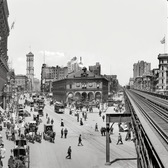 "New York circa 1908. ""Herald Square."" Panorama composed of two 8x10 inch glass negatives, digitally merged, showing Broadway at 34th Street. Landmarks include the New York Herald newspaper building (with its clockwork blacksmith bell-ringers and electrified owls), Sixth Avenue elevated tracks, New York Times building and Hotel Astor. Detroit Publishing Co."