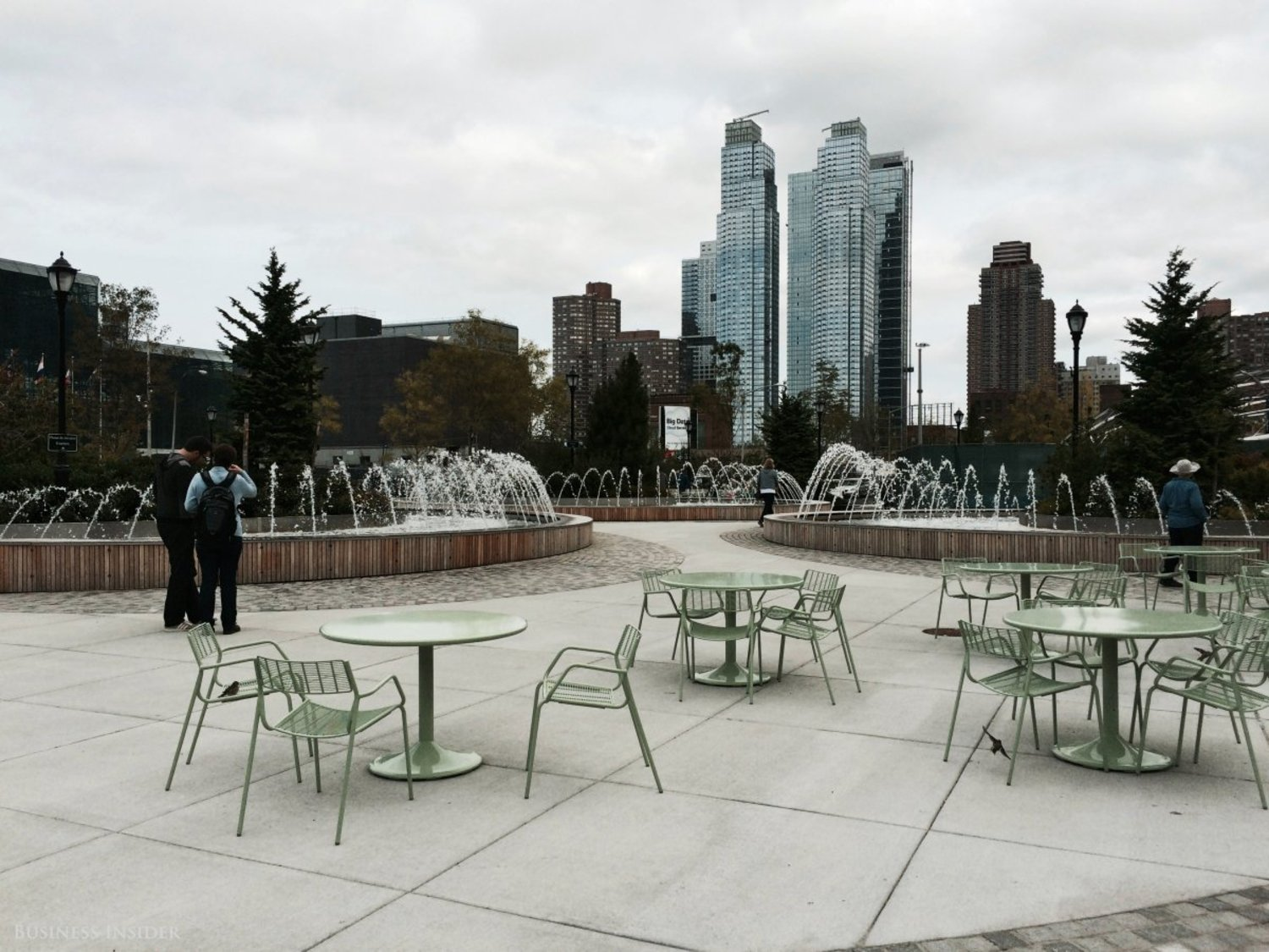 The park offers tables and amphitheater benches in front of three modern fountains and a gorgeous view of towers to the north.