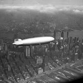 LZ 129 Hindenburg built by the Zeppelin company flies over Manhattan on May 6, 1937. A few hours later, the ship burst into flames in an attempt to land at Lakehurst, New Jersey