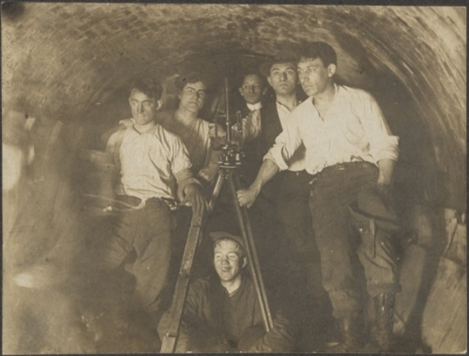 Engineers in tunnel during construction of present IRT at City Hall Station. ca. 1900
