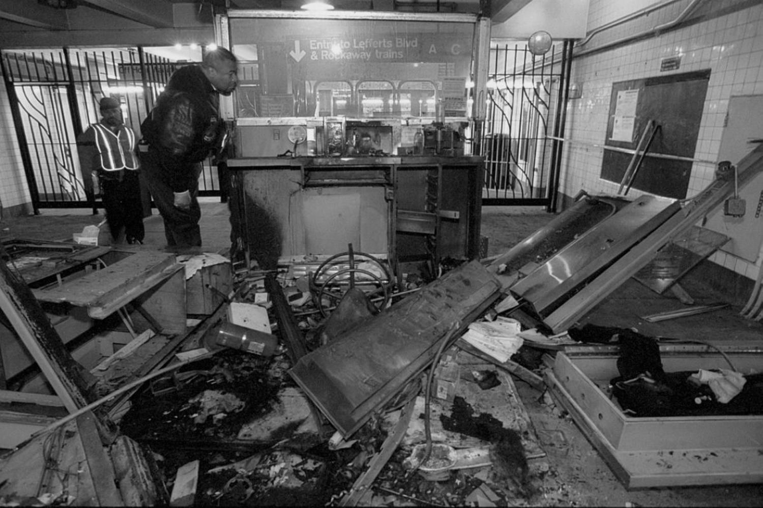 1990's: A firebombed subway token booth at Kingston and Fulton Street lies in ruins following an explosive incident that shook the station in 1995.