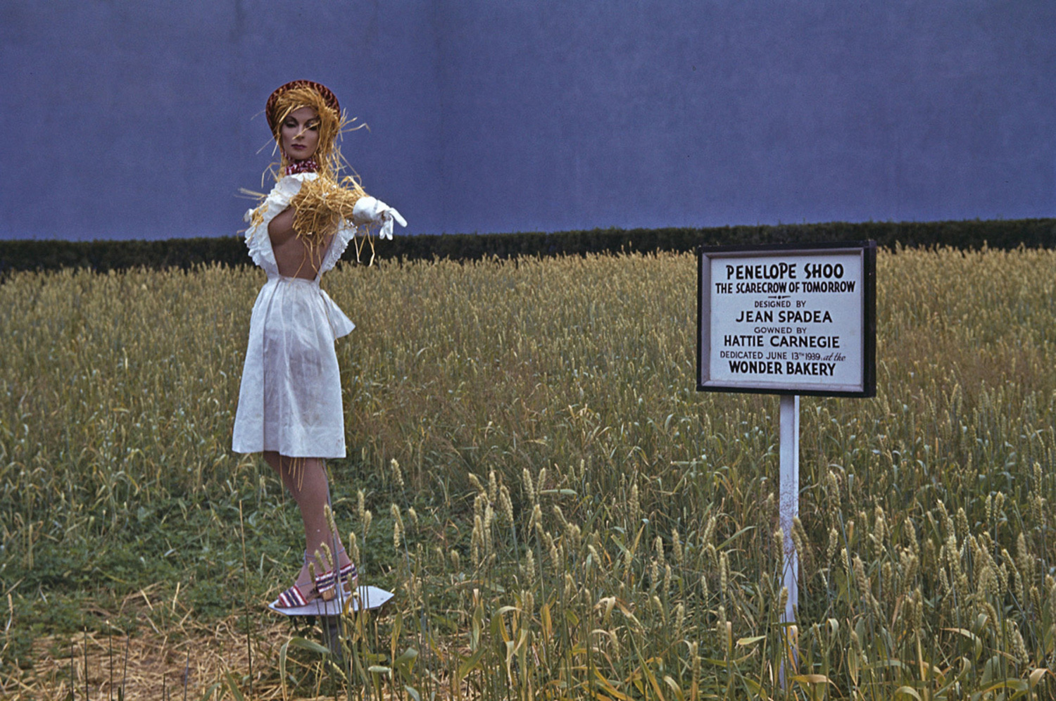 """Wonder Bread Bakery displays a wheat field exhibit at the 1939 New York World's Fair. The """"scarecrow of tomorrow,"""" Penelope Shoo, is wearing an outfit designed by Hattie Carnegie. The wheat field was billed as """"the first planted in New York City since 1875."""""""